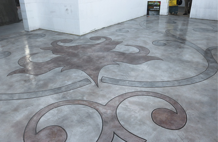 Rick Lobdell and Keefe Duhon placed an overlay system, then cut and stained this concrete floor at Concrete Decor's Decorative Concrete Live at World of Concrete 2018.