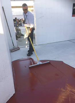 Laticrete applying a premium epoxy coating system at Concrete Decor's Decorative Concrete Live at World of Concrete 2018.