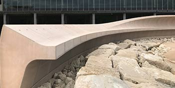 Cresting wave concrete precast to ward off ocean wave power.