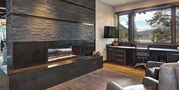 Formed black concrete fireplace brick design.