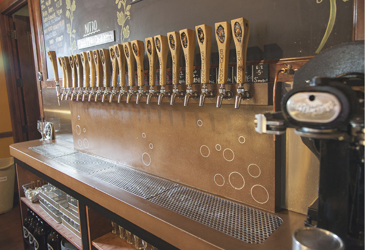 Beer tap wall in bar made from precast concrete, Drain is precast concrete in a terracotta integrally colored concrete.