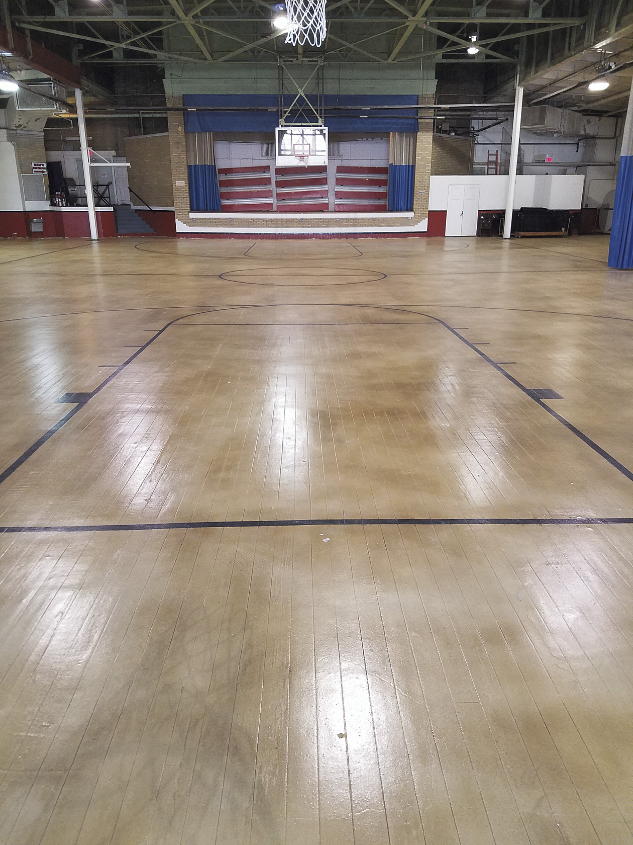 So it was quite a swoosh in his hoop when Bell landed the contract to resurface the 10,000-square-foot floor of the old gym, which had been acquired by the town from the YMCA and was now the Henry Township Community Center.