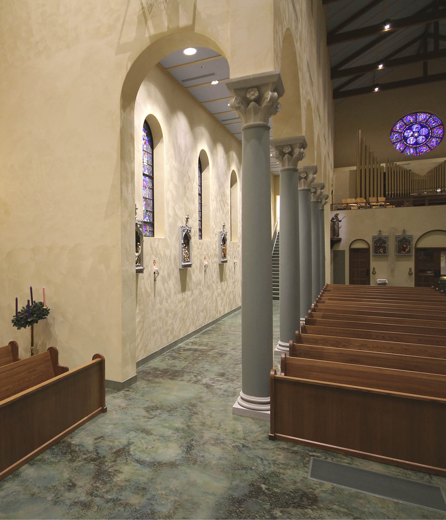 CarolinaCommanding attention on a hilltop in Greenville, South Carolina, the new Our Lady of the Rosary church is as impressive inside as it is outside with soaring arches, reclaimed glass windows and a beautiful marbleized stained concrete floor.