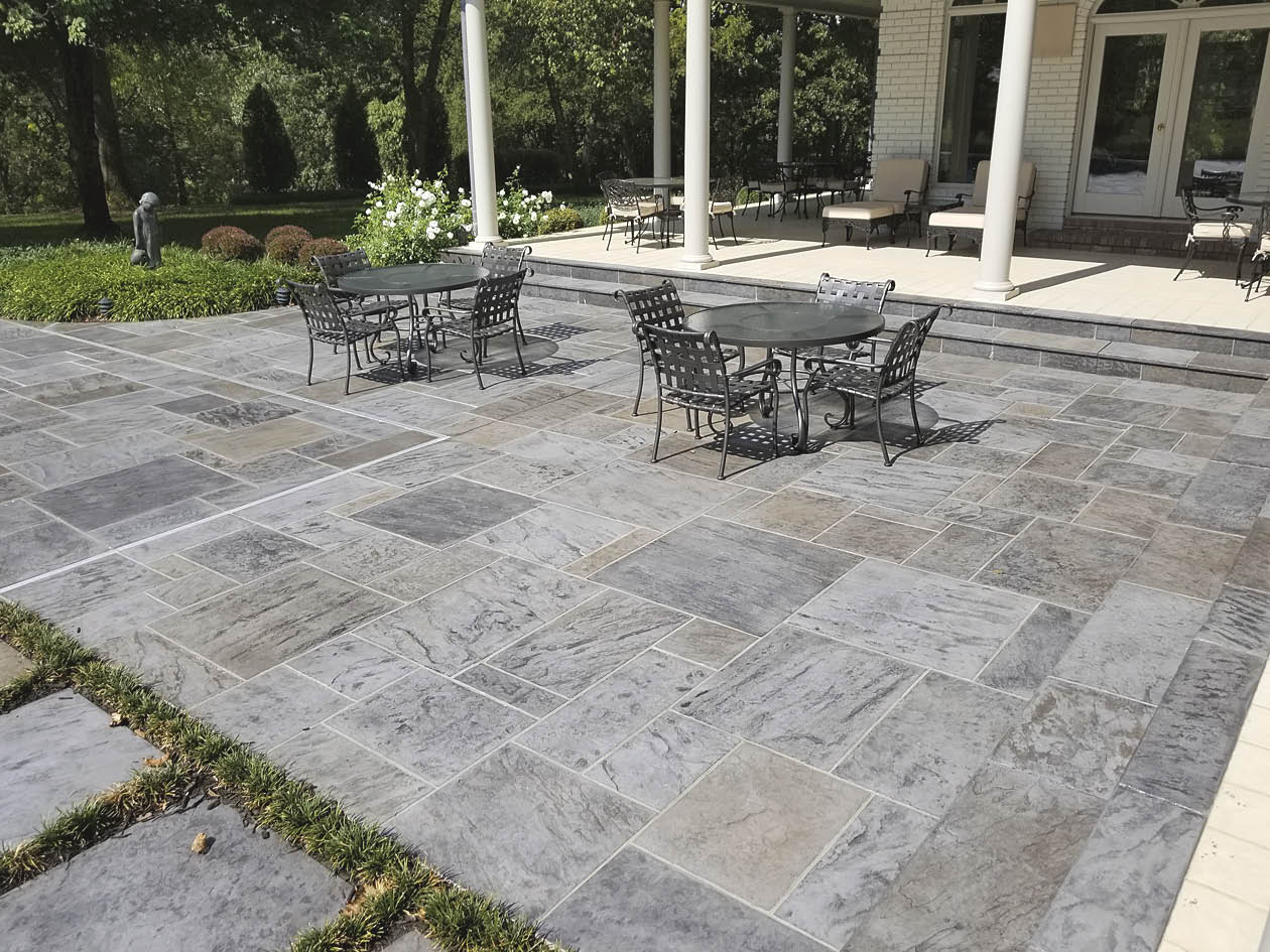 slate stamping pattern and colored the concrete with Scofield Lithochrome Color Hardener in Platinum Gray and with Lithochrome Antiquing Release.