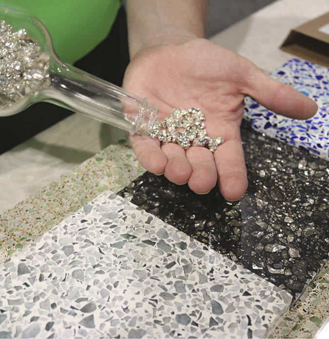 During a recent World of Concrete, a Heritage glass representative displays his company's silver-coated aggregate. Photo from Concrete Decor archives
