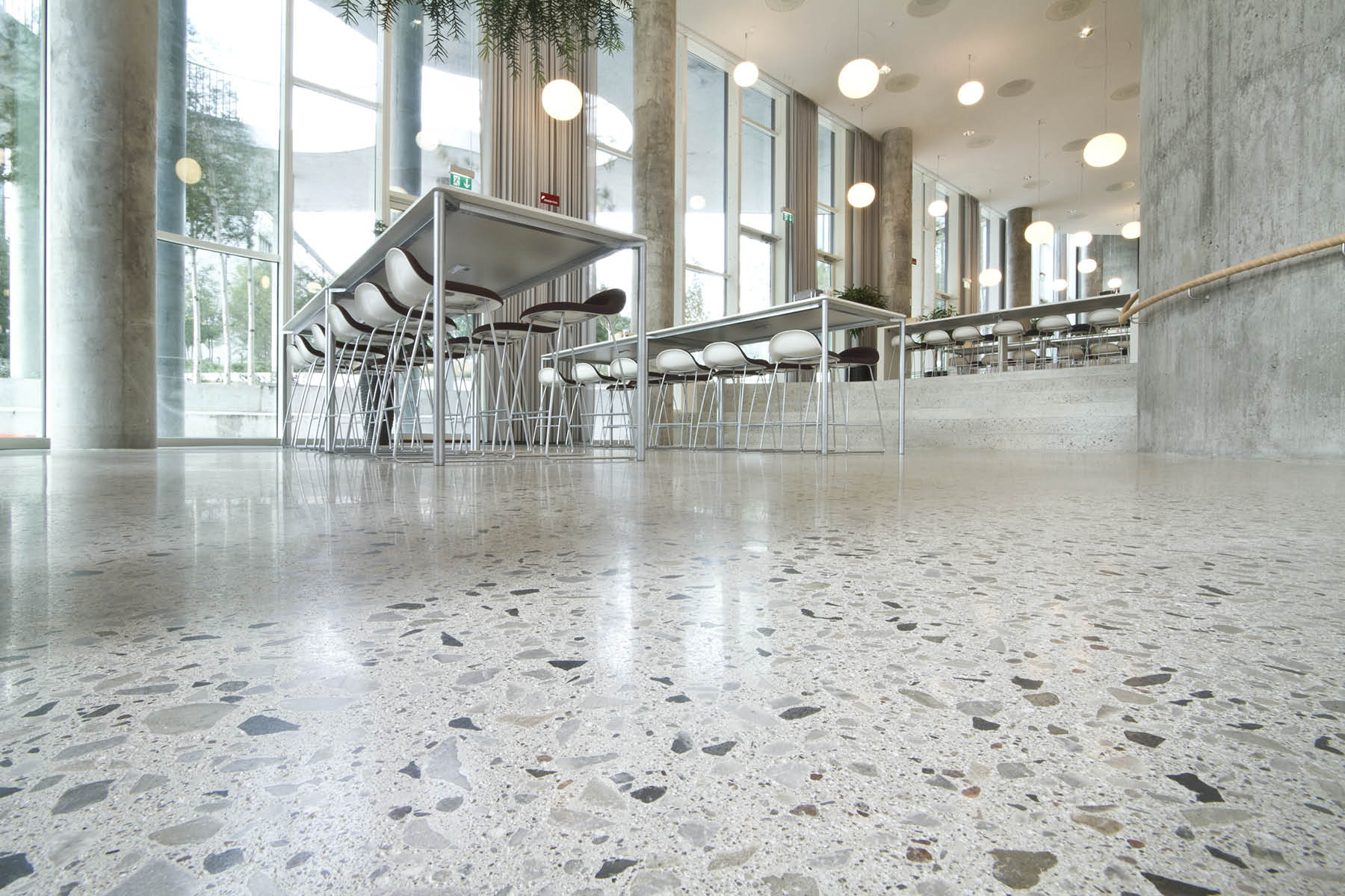 Not all shiny floors are refined polished concrete floors such as this one created with the Husqvarna HiperFloor system. To help the industry deliver more consistent, high-quality floors, task forces are developing guidelines to establish industry-wide specifications for polished floors. Photos courtesy of Husqvarna Construction Products/HTC