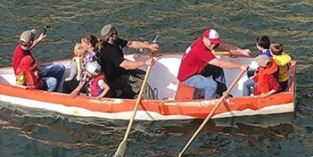 group boating on a concrete boat created at the Mendo Mini