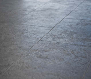 Up close look at a concrete floor with control joints.