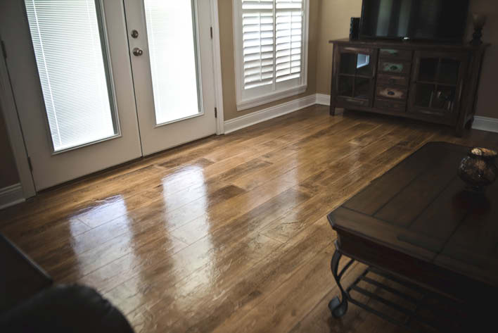 Concrete overlay woodplank in living room space