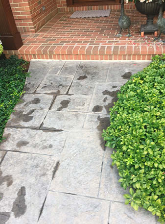 This stamped concrete walkway's original color was extensively faded but was transformed beginning with a thorough scrub and power wash.