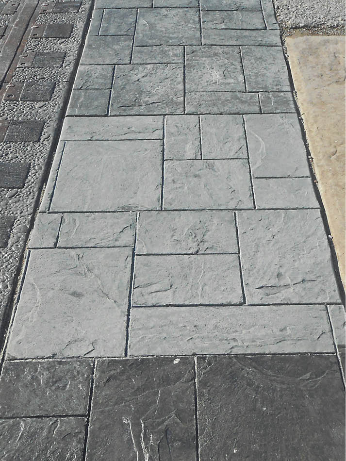 Three different types of sealer yield different colors on this stamped concrete sample.