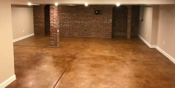 Acid stain concrete in an interior space