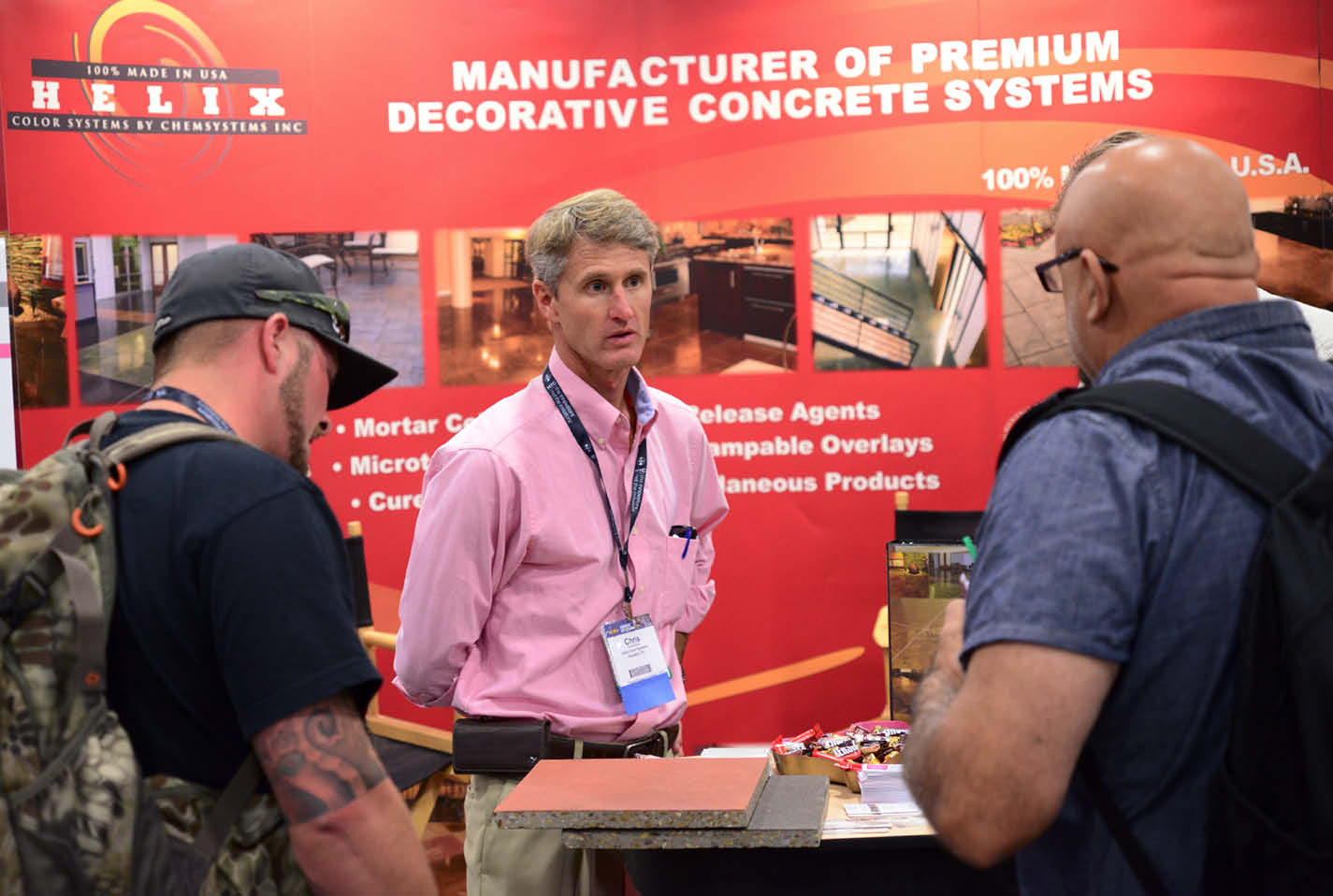 Chris Sullivan converses with Concrete Decor Show attendees at his company's booth. Truly a fount of knowledge, he regularly addresses decorative concrete trends in the educational lineup, as he will do again in 2019.