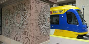 Stenciled wall at a metro station