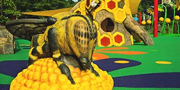 Oversized bee created for a playground at the Smithsonian National Zoo made with GFRC.