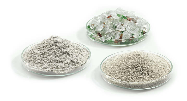 Seen here are dishes of waste glass (middle), glass flour (left) and expanded glass (right).