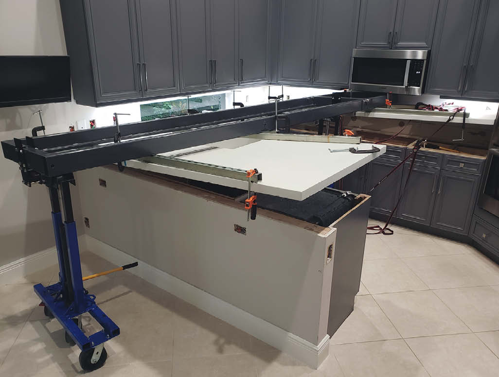 The concrete countertop is moved into place with the King Cart.