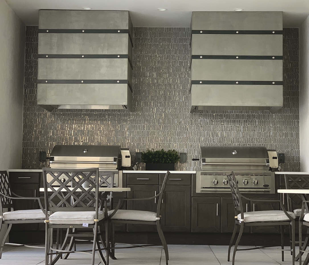Concrete range hoods in a modern outdoor kitchen space