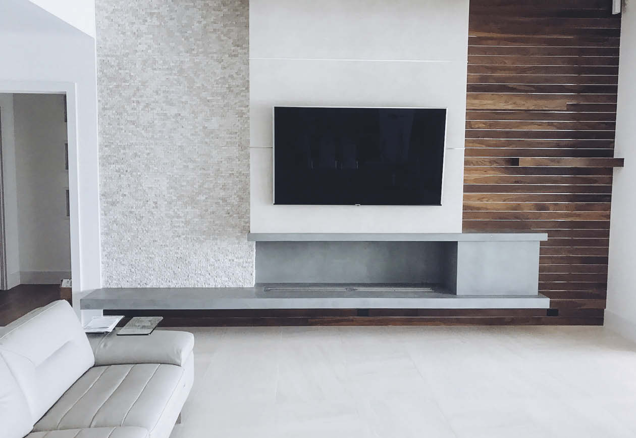 Concrete entertainment console with large flat screen tv.