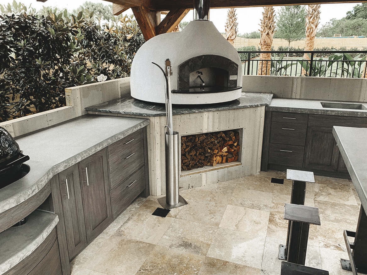 Outdoor concrete pizza oven with concrete countertops for prepping.