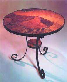 Accent tables such as this red concrete table are striking in many spaces.