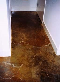 Acid stained hallway in dark browns and black cracks are emphasized giving a marbling look.