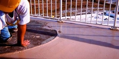 Fixing cracks in concrete decks by using semi-rigid epoxy that allows slight movement.