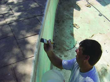 Applying color to concrete with a chip brush.