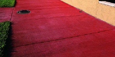 A red admixtures was added to this brilliantly colored sidewalk with a broom finish.