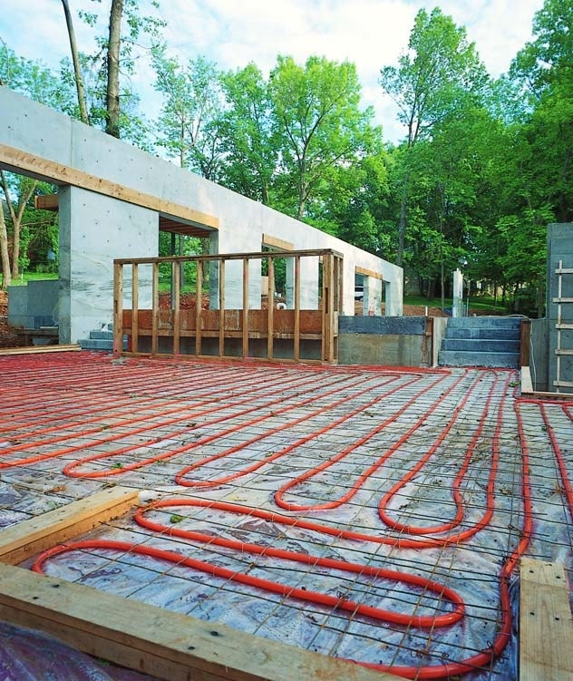 Radiant heating coils placed prior to concrete.