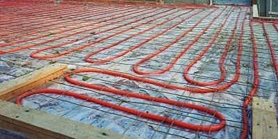 Heating tubes seen in a yet to be poured concrete slab. Will be used to heat the house with warm radiant floor heating system.