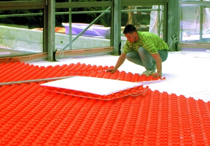 Schluter System vapor barrier can be used between the radiant heating element and the concrete.