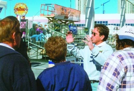 Tom Ralston talking with potential customers at the World of Concrete 2003.