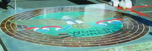 World of Concrete 2003 eagle stained on concrete with a circle of brick also with concrete stains circles the eagle.