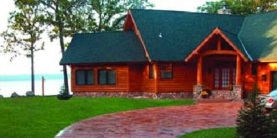 Vacation homes can have stamped or stained concrete surrounds that hold up to extreme weather conditions and look beautiful while doing it.