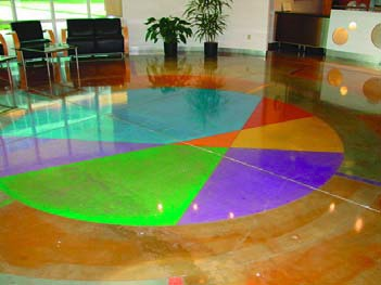 Bright colors on a concrete floor are achieved with acrylic stains