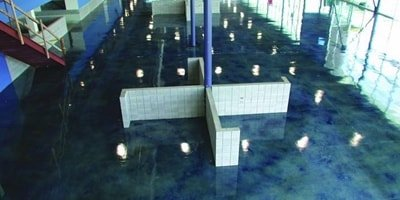 Acrylic stained concrete with blue hues in a GM showroom