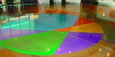 Polished and dyed concrete in bright colors or teal, green, orange, red, yellow and purple.