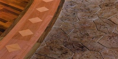 A close up look at stamped and stained concrete butted up next to each other.