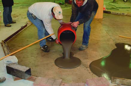 An overlay is applied to a properly prepared and primed concrete surface.