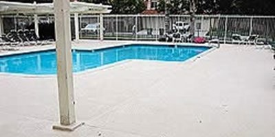 Polymer-modified concrete on a pool deck