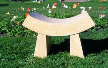 Concrete bench by Buddy Rhodes has a Asian inspiration with the curved seating area.