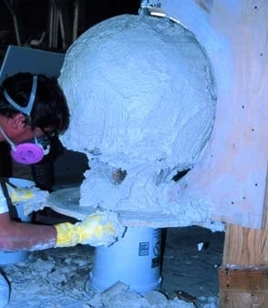 Manufacturing a concrete ball or sphere using a mold to shape the concrete.