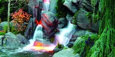 Maintenance is minimal on outdoor concrete waterfalls. The UV light is the most damaging.