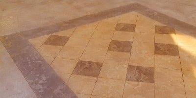 Cementitious overlay product in a checker board pattern by Life Deck, Texture-Crete.