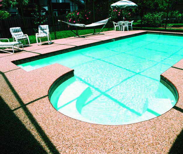 Putting an epoxy pebble system around a pool deck is a great idea for water issues