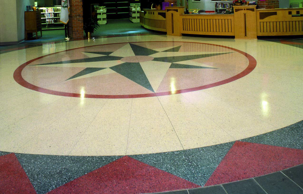 Another shot of an epoxy aggregate floor that is made to look like a compass rose.