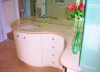 A bathroom vanity with concrete countertop