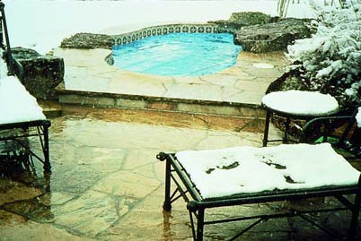 Snow melt systems have benefits on a pool deck to avoid the temperature change on feet when leaving the tub.