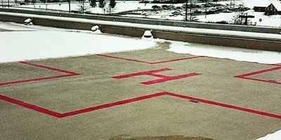 Concrete helipad with a snowmelt system installed